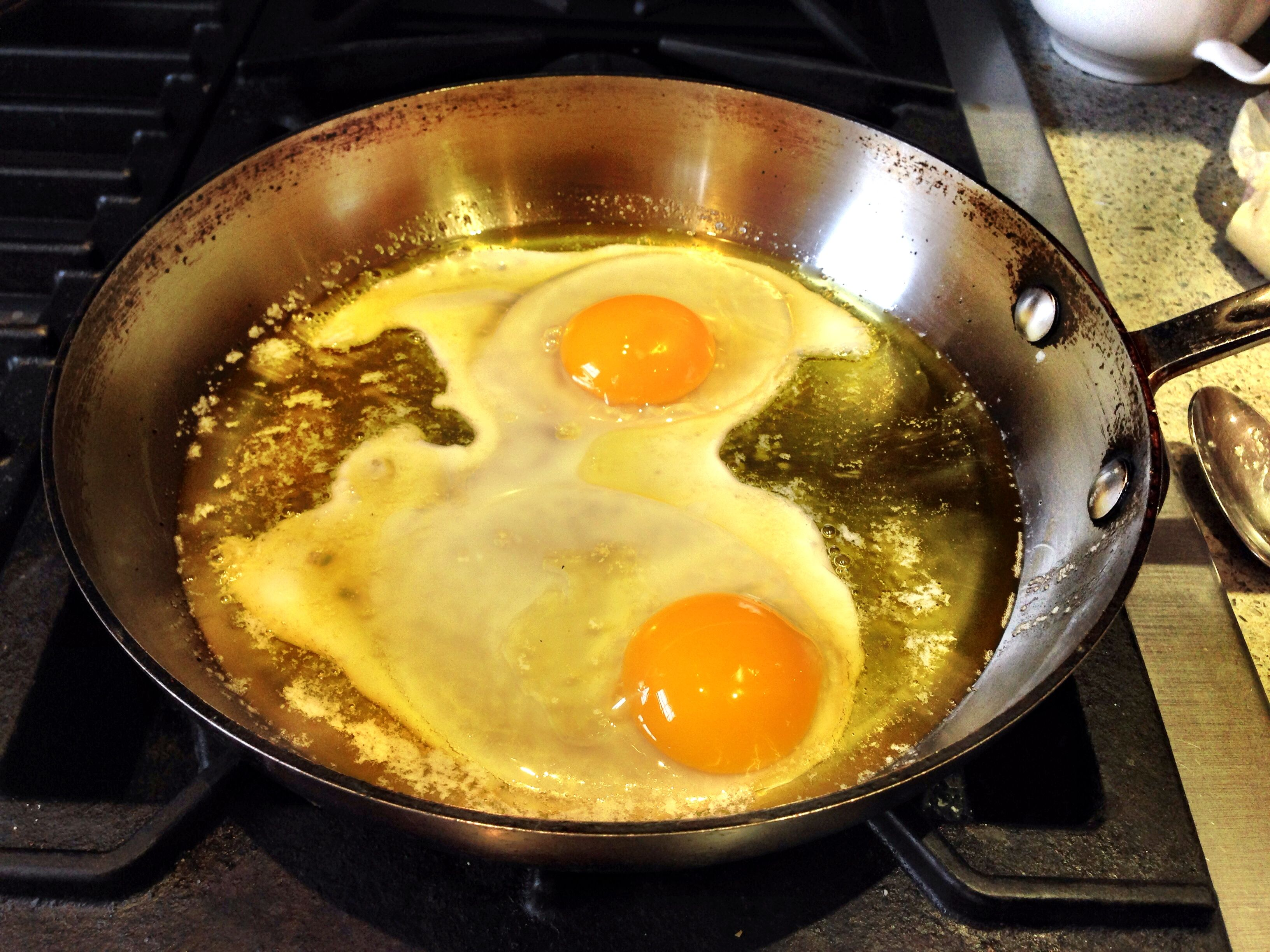 Olive_oil_poached_egg_in Pan Most Recipes For Poaching An Egg